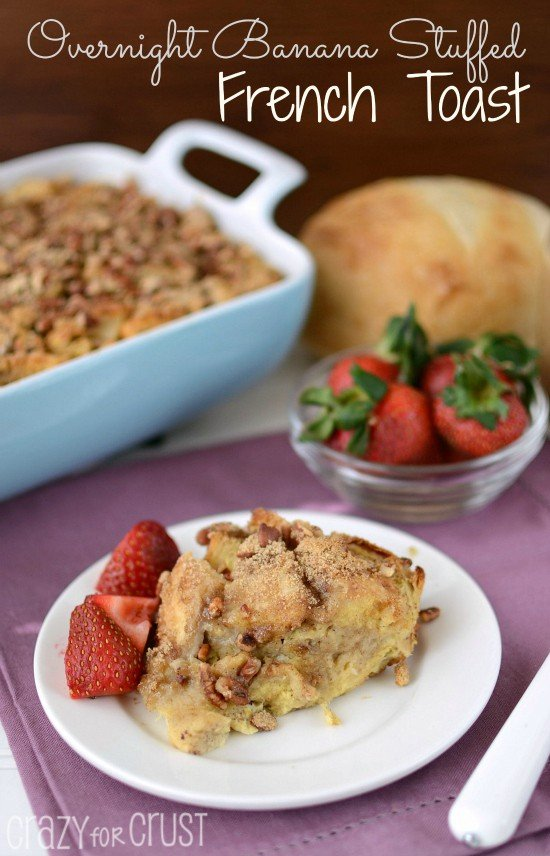 banana baked french toast on white plate with berries