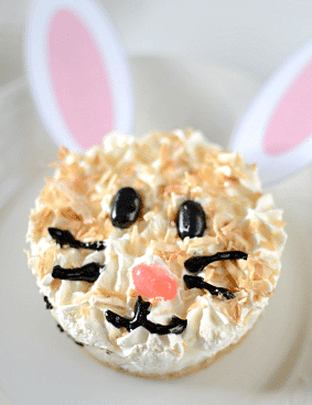 pie with whipped cream on top turned into a bunny face with paper ears
