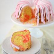 pink lemonade swirl bundt cake on stack of white plates
