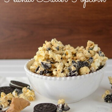 oreo peanut butter popcorn in white bowl with words on photo