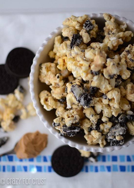 oreo peanut butter popcorn in white bowl overhead shot