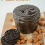 Oreo Peanut Butter in a jar with oreos and peanuts around on cutting board with words on photo