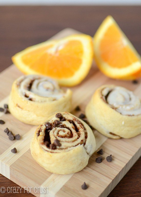 orange sweet rolls with and without icing on cutting board