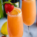 close up of lemon strawberry mimosa in flute
