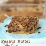 peanut butter coffee cake on parchment paper on teal napkin with words on photo