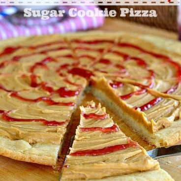 peanut butter and jelly cookie pizza with slice cut