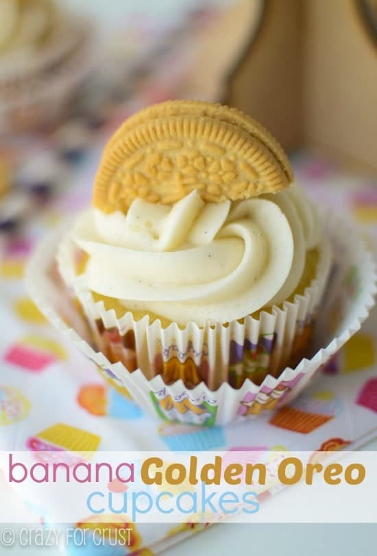 Banana Golden Oreo Cupcakes with frosting and half a golden oreo on top