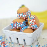 ice cream sandwiches made with small cookies and sprinkles in a stack in a basket