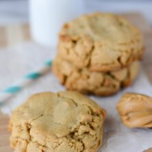 large peanut butter cookies on parchment paper