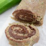 sliced zucchini cake roll with chocolate filling on white platter