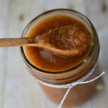 crockpot applesauce in jar with spoon