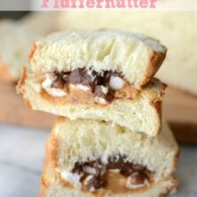 sandwich with peanut butter and chocolate and marshmallows sliced in a stack