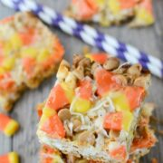 overhead shot of stack of candy corn magic bars with candy corn candy around