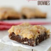 german chocolate brownie with coconut pecan frosting on parchment paper