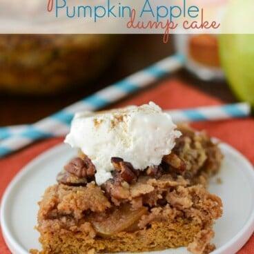 pumpkin apple dump cake slice on white plate with whipped cream