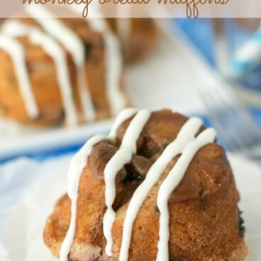 blueberry monkey bread muffin on white plate with drizzle