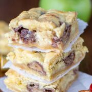 stack of gooey bars with rolos and apples