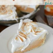 pumpkin pie slice topped with meringue on white plate