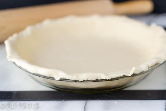 All Butter Pie Crust inside of a pie baking dish