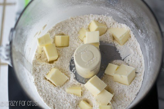 combining ingredients to make an all butter pie crust