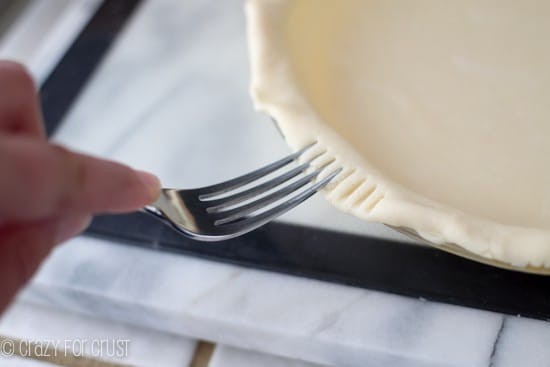 crimping an All Butter Pie Crust with a fork