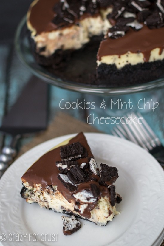Cookies and Mint Chip Cheesecake on clear serving tray with one slice sitting below it on a white plate