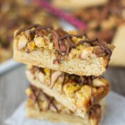 stack of maple nut bars on parchment paper