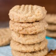 Stack of Peanut Butter Snickerdoodles on parchment paper with title