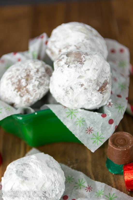 Rolo Stuffed Chocolate Snowballs on holiday paper
