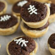 mini pies with crust and brownies inside decorated to look like footballs