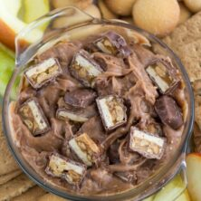 Overhead shot of snicker dip with apples and cookies and title