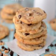 Stack of toffee chocolate chippers on parchment paper with title