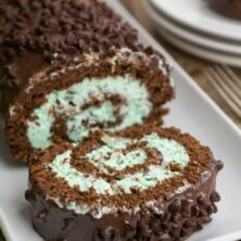 chocolate cake roll with green mint chip filling on white platter