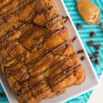 overhead shot of peanut butter monkey bread in loaf shape on white plate
