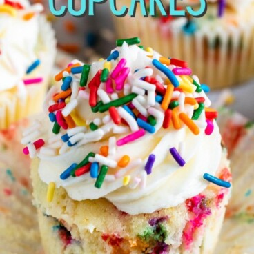 cupcake with sprinkles and frosting and words on photo