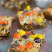sliced oatmeal cookie bars with reese's on top on rustic wood surface