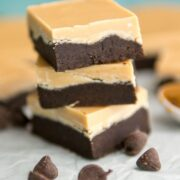 stack of peanut butter cookie dough bars on parchment