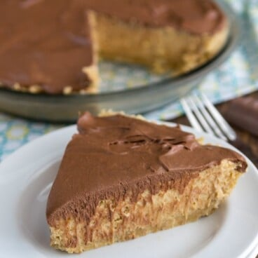 slice of peanut butter pie with chocolate top on white plate