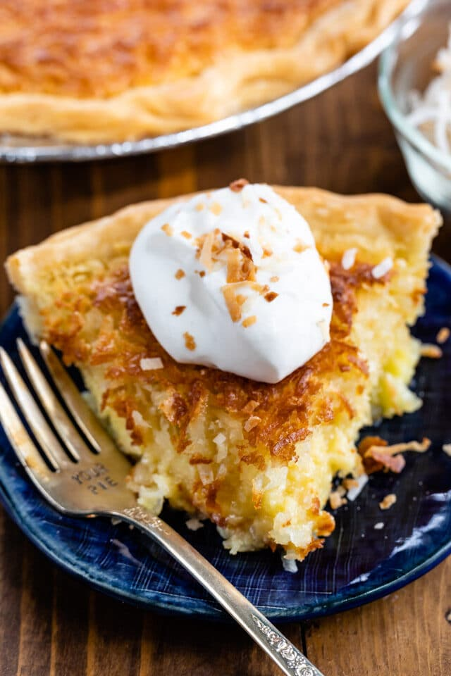 slice of coconut chess pie on blue plate