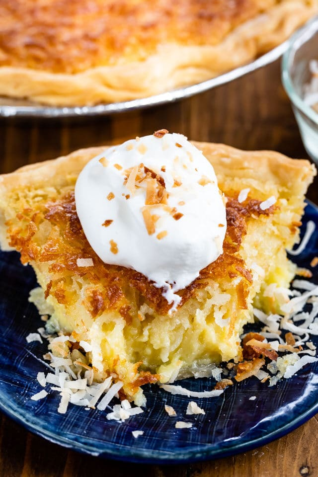 slice of coconut chess pie on blue plate with slice missing