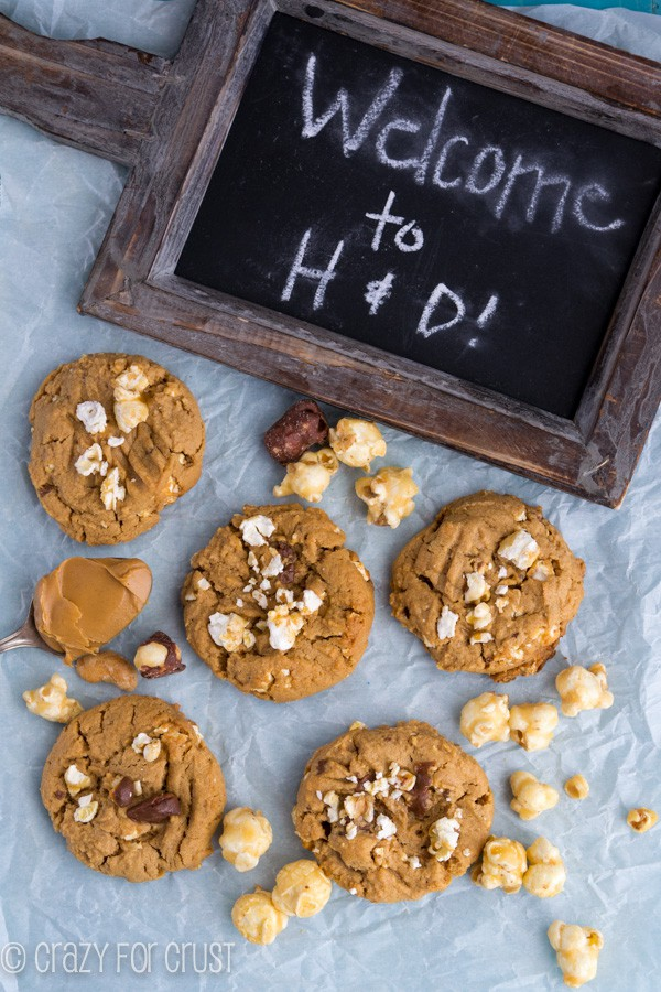 Overhead shot of Moose Munch Peanut Butter Cookies and a wooden chalkboard sign that says Welcome to H&D!