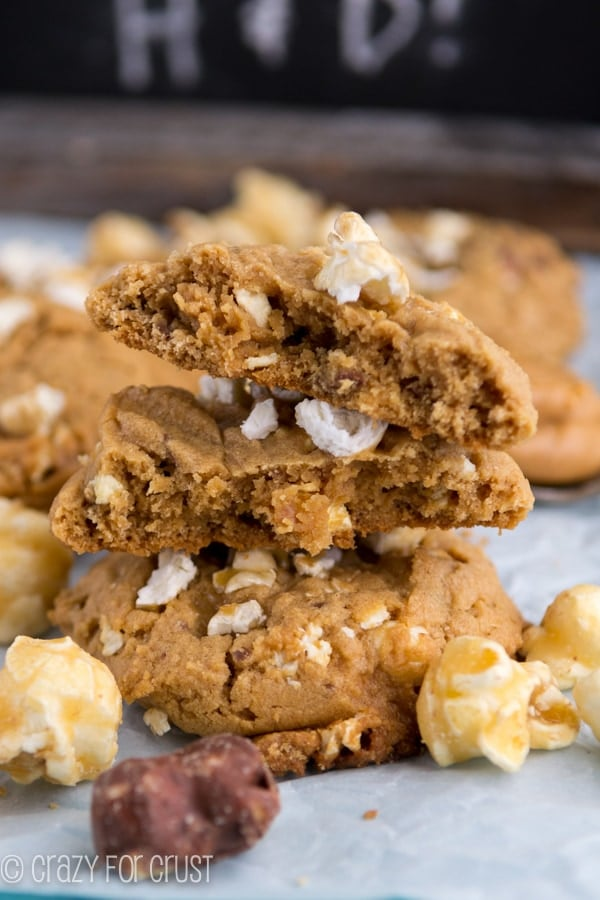 Stack of Moose Munch Peanut Butter Cookies with ingredients around the cookies