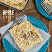 2 slices of Apple Slab Pie on 2 blue plates on a wooden board