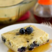 Blueberry Banana Baked Pancake on a white plate on a wooden board