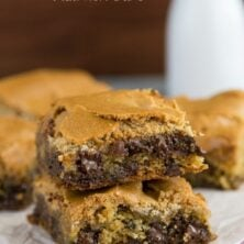 Chocolate Chip Cookie Mud Hen Bars Recipe - melty chocolate chip cookie topped with a brown sugar meringue sitting on parchment paper