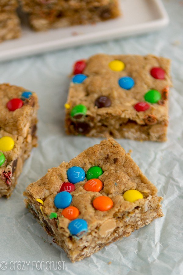 Loaded Oatmeal Blondies sitting on parchment paper