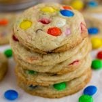 M&M Sugar Cookies stacked on top of each other with M&Ms spread around