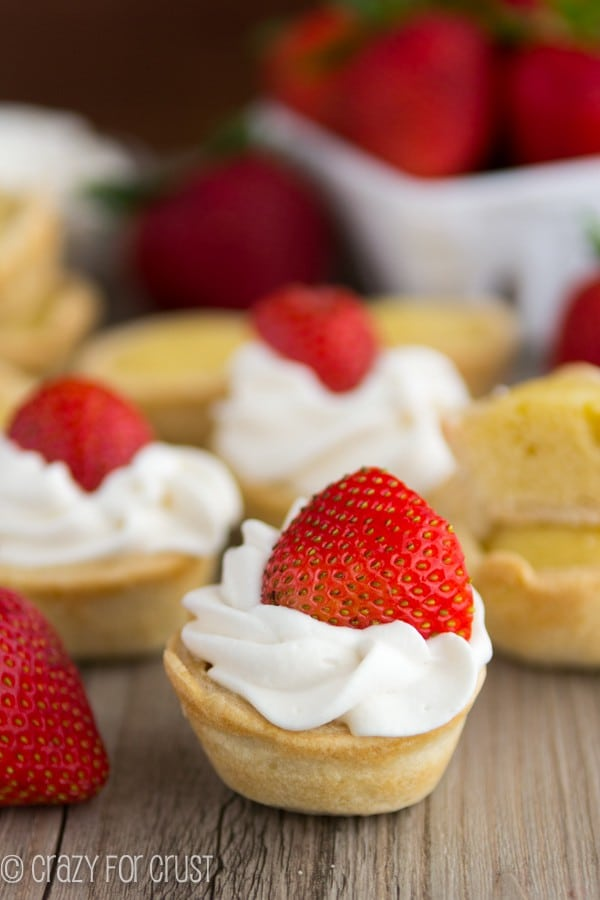Mini Strawberry Shortcake Pies on a wooden board