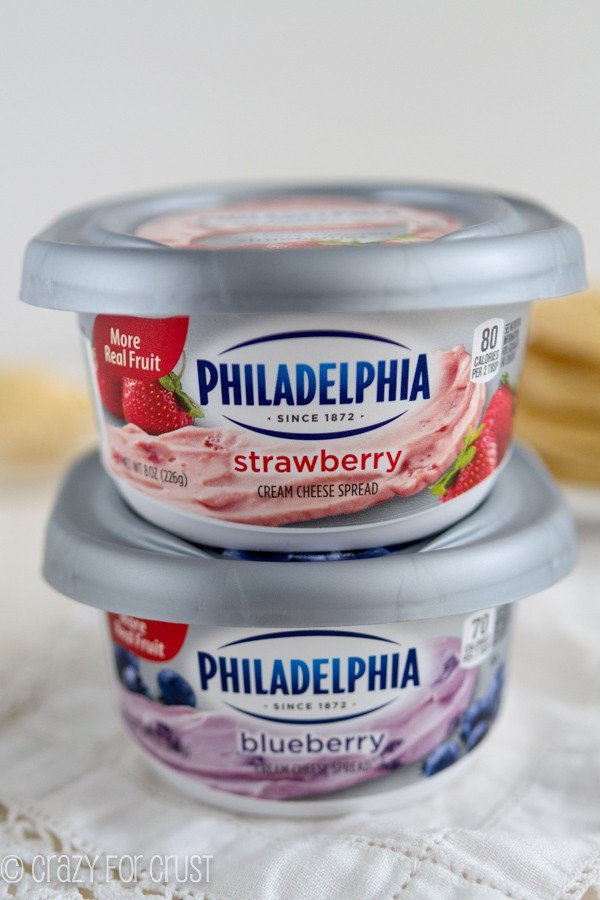 Philadelphia strawberry and blueberry cream cheese stacked on top of each other