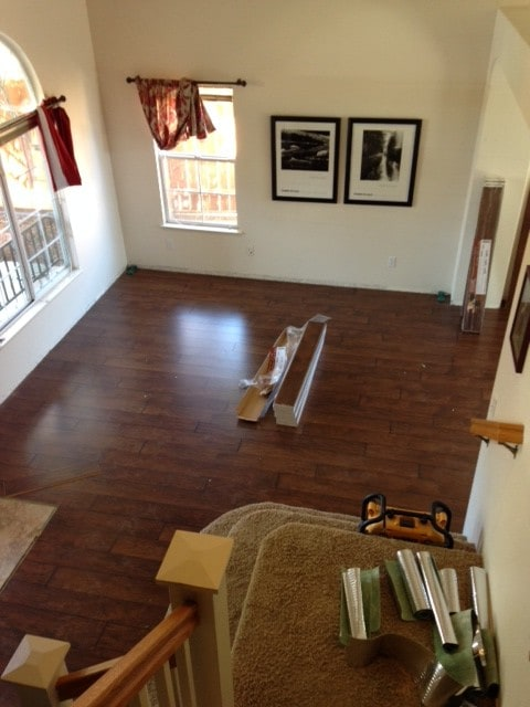 A living room with hardwood floors and no furniture in it